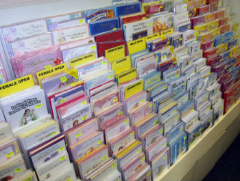A selecton of greeting cards in a rack ready for sale
